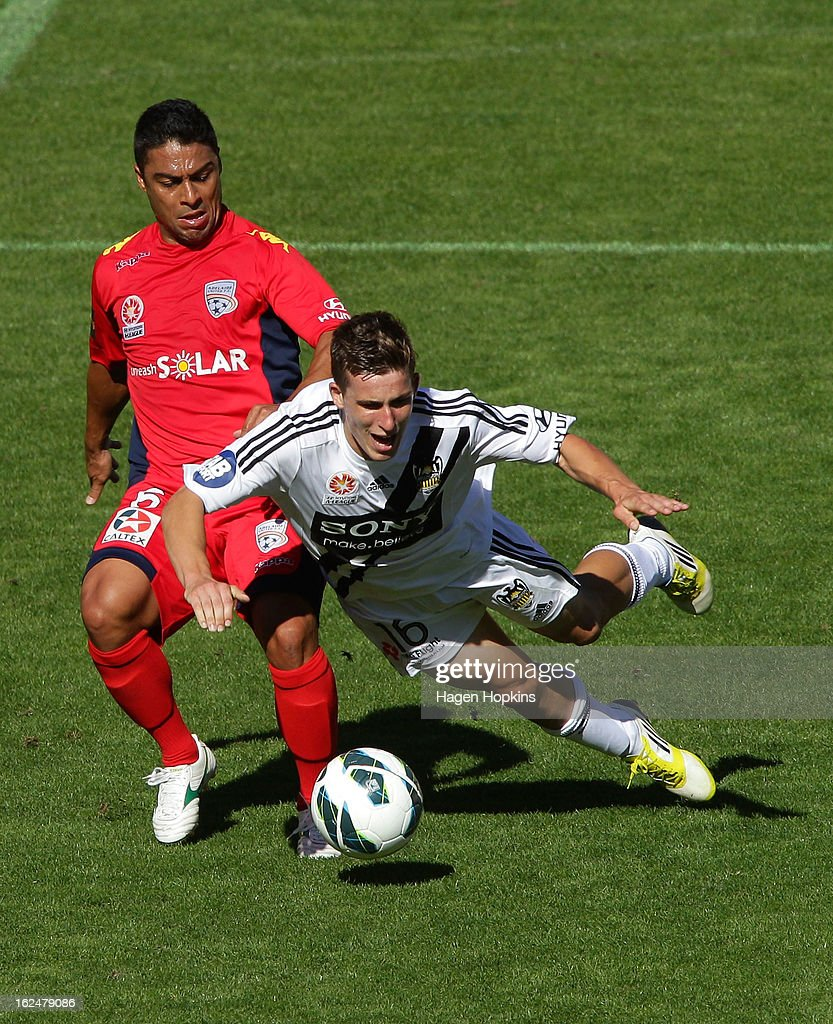 Louis Fenton of the Phoenix is brought down in the tackle of Cassio of Adelaide during the round 22 A-League match between the Wellington Phoenix and Adelaide United at Westpac Stadium on February 24, 2013 in Wellington, New Zealand.
