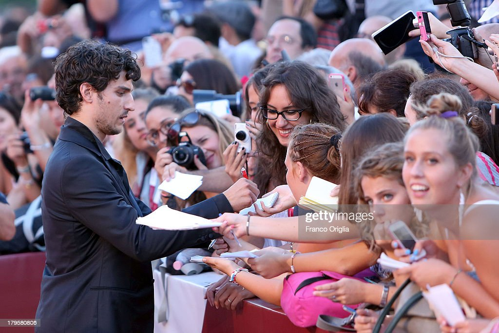 <a gi-track='captionPersonalityLinkClicked' href=/galleries/search?phrase=Louis+Garrel&family=editorial&specificpeople=868484 ng-click='$event.stopPropagation()'>Louis Garrel</a> signs autographs during the 'Jealousy' Premiere during the 70th Venice International Film Festival at the Palazzo del Cinema on September 5, 2013 in Venice, Italy.