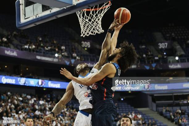 Louis Labeyrie of France vies with Thanasis Antetokounmpo of Greece during the basketball European Championships Eurobasket 2017 qualification round...