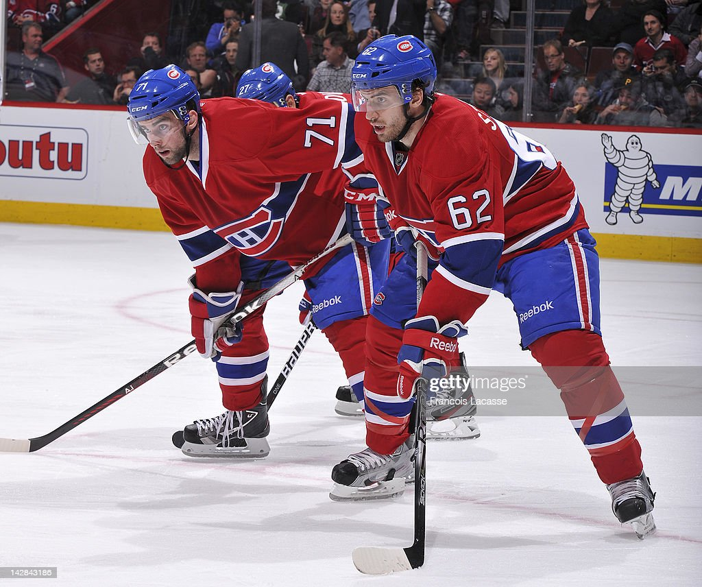 Louis Leblanc and Frederic StDenis of the Montreal Canadiens line up for a faceoff a against the Tampa Bay Lightning during the NHL game on April 4...