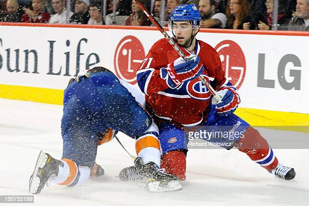 Louis Leblanc of the Montreal Canadiens gets up after colliding with Mark Streit of the New York Islanders during the NHL game at the Bell Centre on...