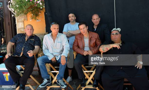 Louis Lombardi Paul BenVictor James Russo and William DeMeo on the set of 'The Neighborhood' on June 20 2017 in New York City