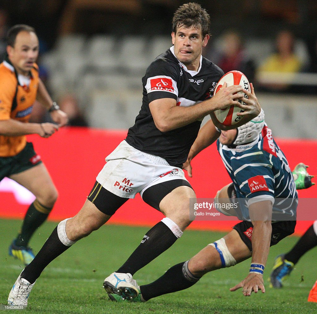 Louis Ludik gets past Leon Karemaker during the Absa Currie Cup match between The Sharks and GWK Griquas at Mr Price KINGS PARK on October 12, 2012 in Durban, South Africa.
