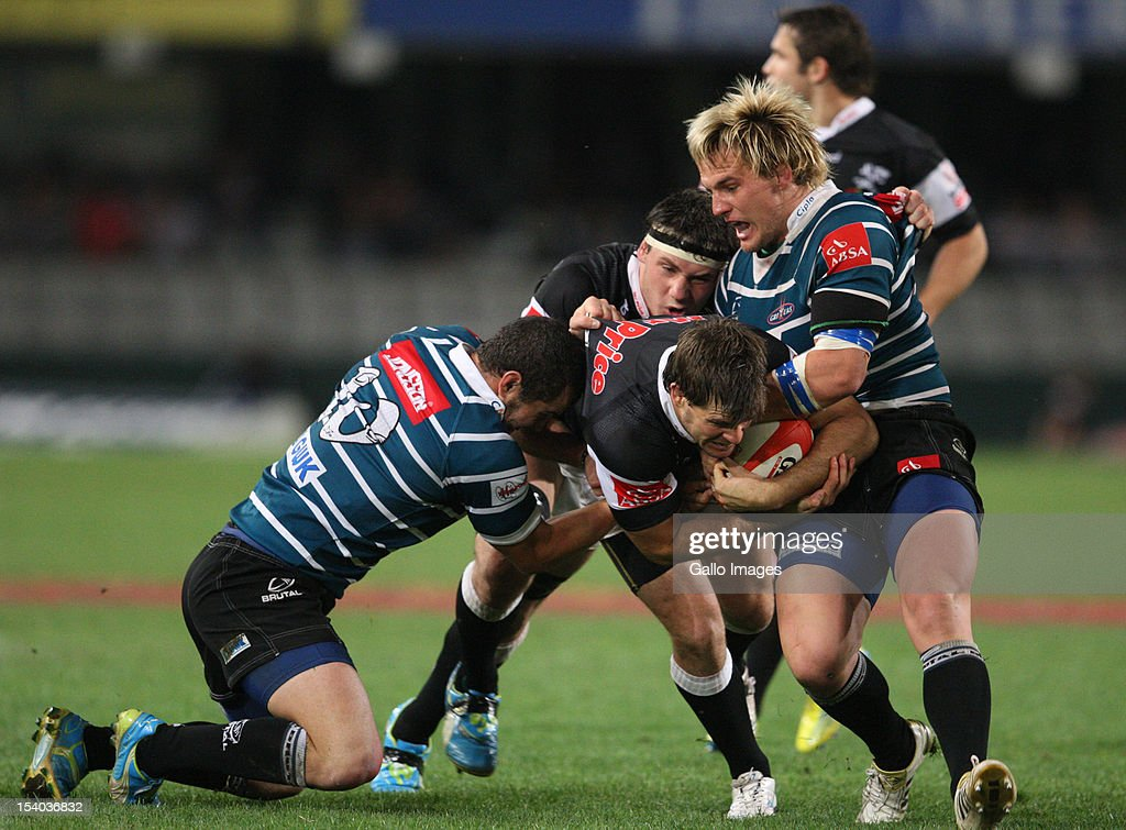 Louis Ludik is tackled by Marnus Schoeman and Francois Brummer during the Absa Currie Cup match between The Sharks and GWK Griquas at Mr Price KINGS PARK on October 12, 2012 in Durban, South Africa.