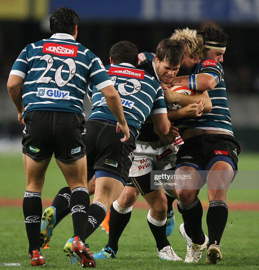 Louis Ludik is well tackled during the Absa Currie Cup match between The Sharks and GWK Griquas at Mr Price KINGS PARK on October 12, 2012 in Durban, South Africa.