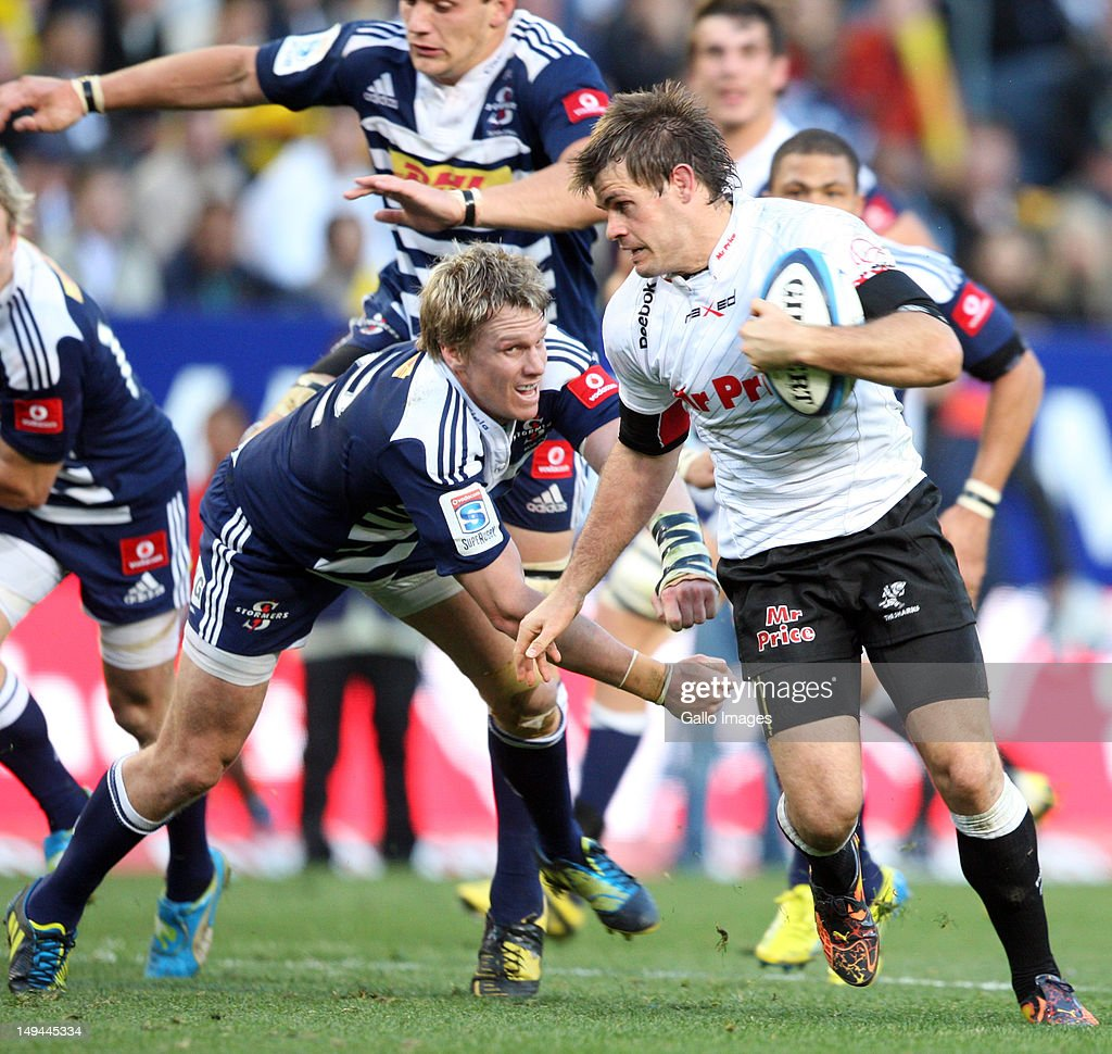 Louis Ludik of Sharks on the attack as Jean de Villiers of Stormers fails to tackle during the Super Rugby semi final match between DHL Stormers and The Sharks from DHL Newlands Stadium on July 28, 2012 in Cape Town, South Africa.