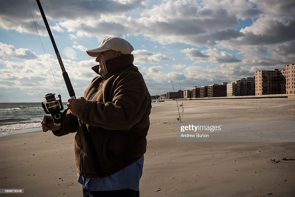 Louis Medina fishes for striped bass on October 25 2013 in Long Beach New York The Long Beach boardwalk was severely damaged by Superstorm Sandy last...