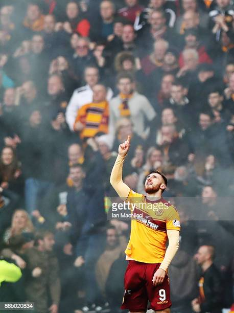 Louis Moult of Motherwell celebrates after he scores the opening goal during the Betfred League Cup Semi Final between Rangers and Motherwell at...