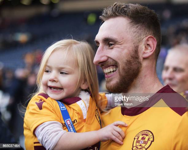 Louis Moult of Motherwell celebrates the end with his daughter Isla after the Betfred Cup Semi Final at Hampden Park on October 22 2017 in Glasgow...