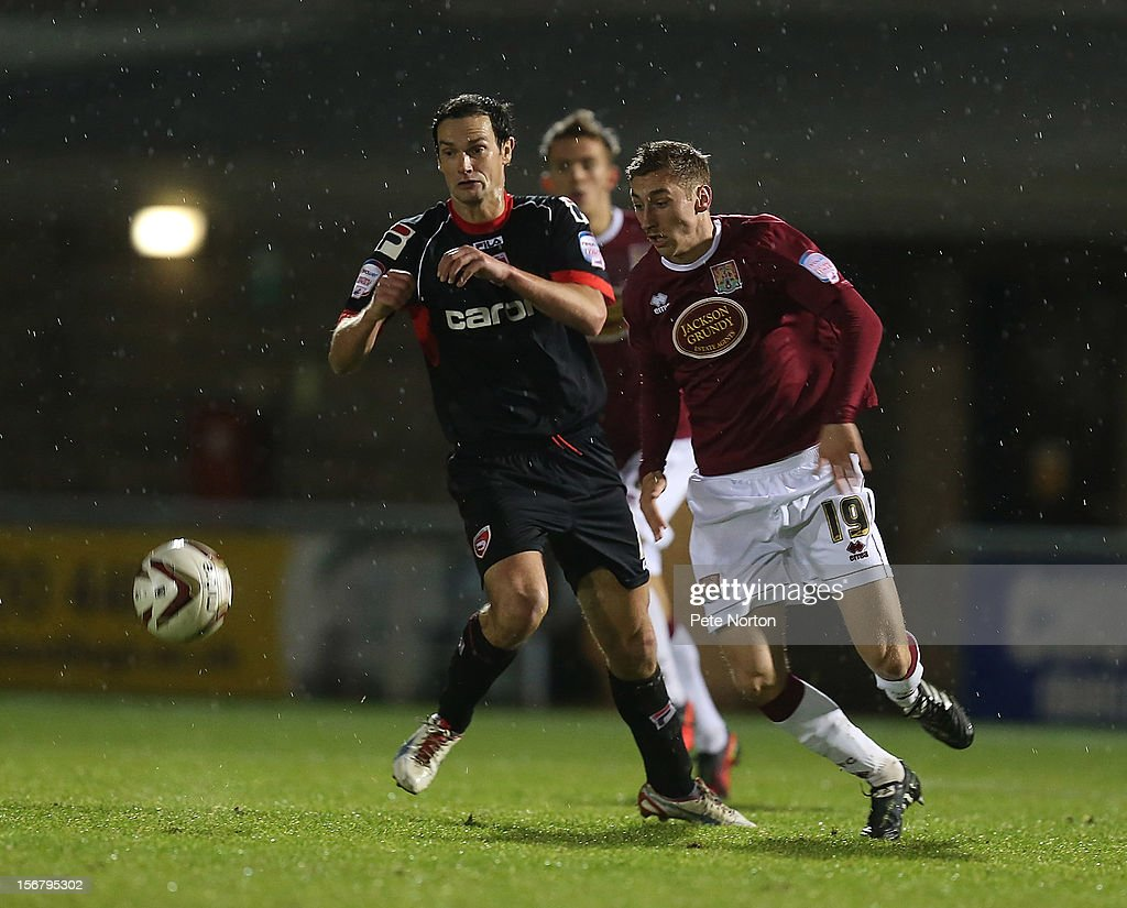 Louis Moult of Northampton Town looks for the ball with Stewart Drummond of Morecambe during the npower League Two match between Northampton Town and Morecambe at Sixfields Stadium on November 20, 2012 in Northampton, England.