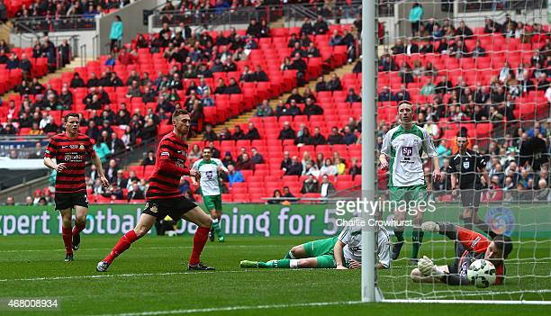 Louis Moult of Wrexham scores the first goal of the game during the The FA Carlsberg Trophy Final match between North Ferriby United and Wrexham at...