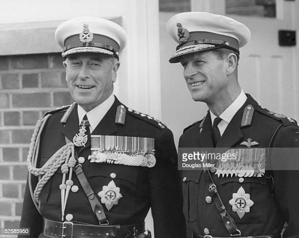 Louis Mountbatten 1st Earl Mountbatten of Burma with his nephew Prince Philip Duke of Edinburgh in Royal Marines uniforms at the regiment's barracks...