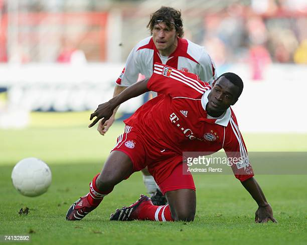 Louis Ngwat Mahop of Munich vies for the ball with Steffen Baumgart of Cottbus during the Bundesliga match between Energie Cottbus and Bayern Munich...