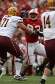 Louis Nzegwu of the Wisconsin Badgers rushes against Brice Schwab of the Arizona State Sun Devils at Camp Randall Stadium on September 18 2010 in...