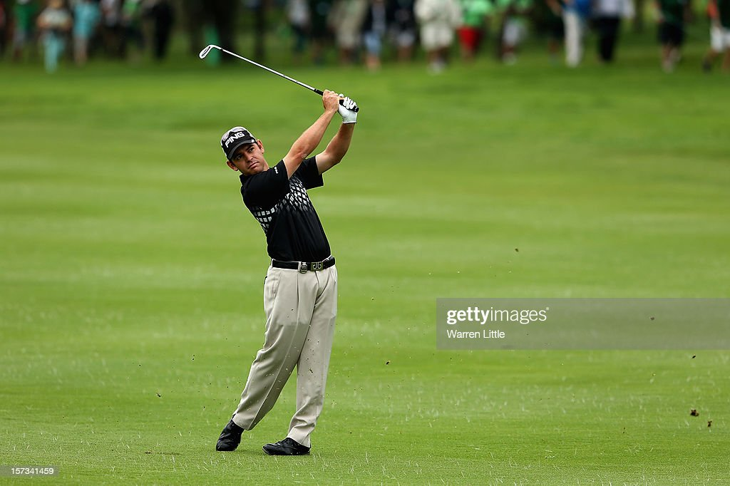 Louis Oosthizen of South Africa plays his second shot into the first green during the final round of the Nedbank Golf Challenge at the Gary Player Country Club on December 2, 2012 in Sun City, South Africa.