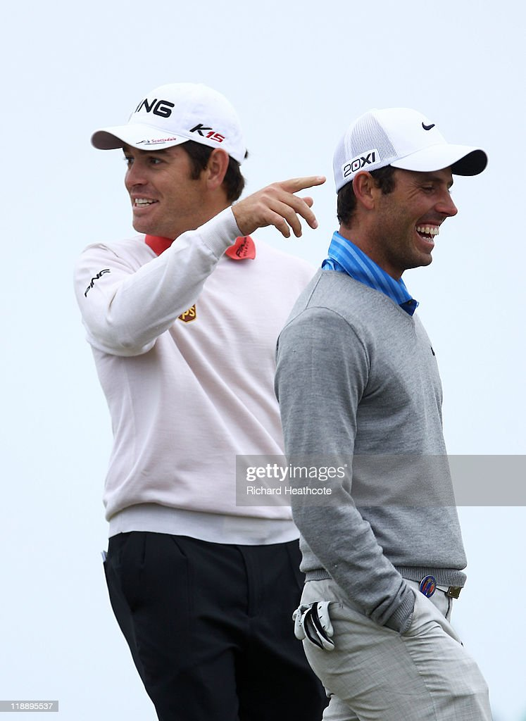 Louis Oosthuizen (L) and Charl Schwartzel of South Africa have a laugh together during the second practice round during The Open Championship at Royal St. George's on July 12, 2011 in Sandwich, England. The 140th Open begins on July 14, 2011.