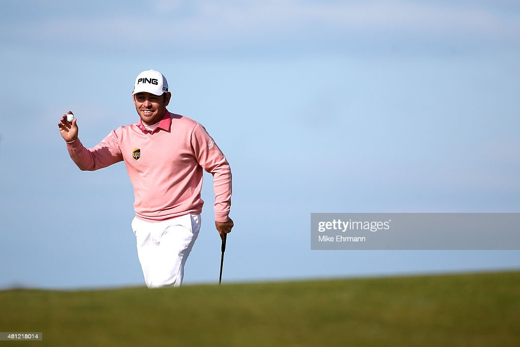 <a gi-track='captionPersonalityLinkClicked' href=/galleries/search?phrase=Louis+Oosthuizen&family=editorial&specificpeople=241573 ng-click='$event.stopPropagation()'>Louis Oosthuizen</a> of South Africa acknowledges spectators on the13th green during the second round of the 144th Open Championship at The Old Course on July 18, 2015 in St Andrews, Scotland.