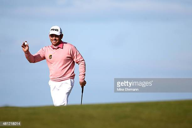 Louis Oosthuizen of South Africa acknowledges spectators on the13th green during the second round of the 144th Open Championship at The Old Course on...