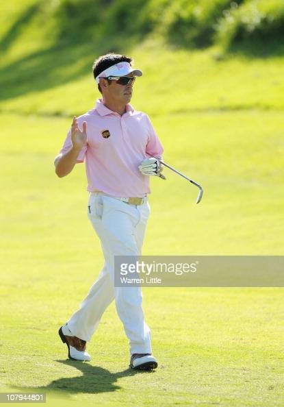 Louis Oosthuizen of South Africa acknowledges the crowd after playing his second shot on the first playoff hole into the 18th green during the final...