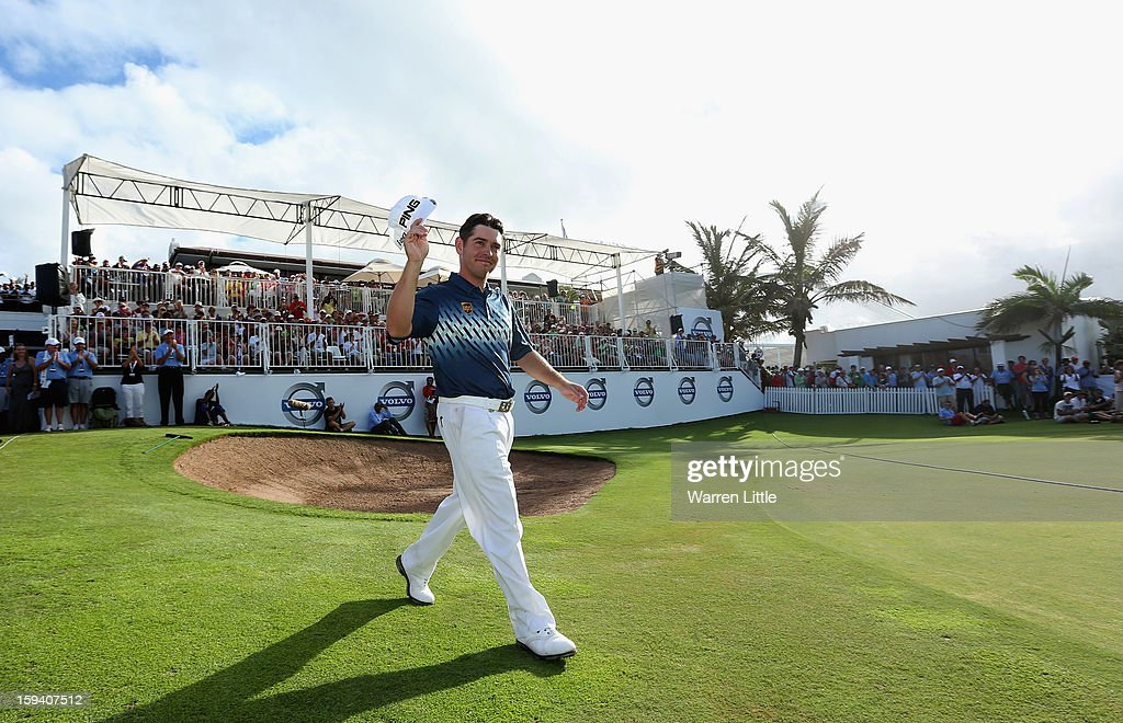 Louis Oosthuizen of South Africa acknowledges the crowd as he walks onto the 18th green to receive the trophy after the final round of the Volvo Golf Champions at Durban Country Club on January 13, 2013 in Durban, South Africa.