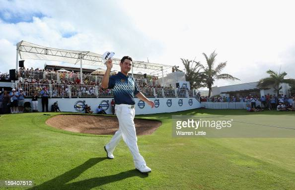 Louis Oosthuizen of South Africa acknowledges the crowd as he walks onto the 18th green to receive the trophy after the final round of the Volvo Golf...