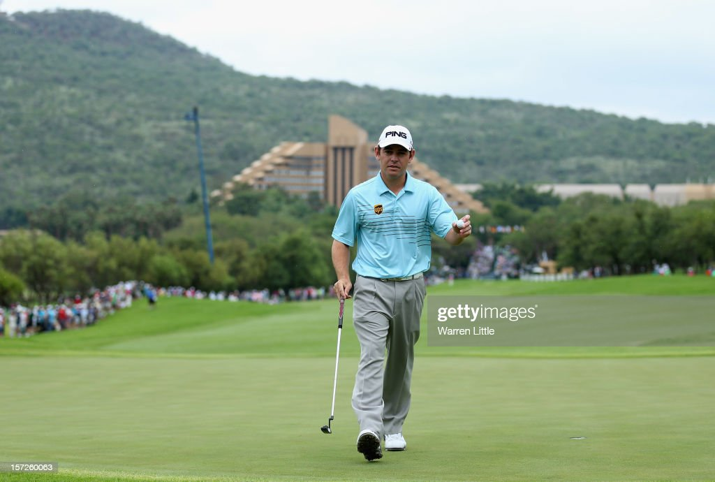 Louis Oosthuizen of South Africa acknowledges the crowd on the first green during the third round of the Nedbank Golf Challenge at the Gary Player Country Club on December 1, 2012 in Sun City, South Africa.