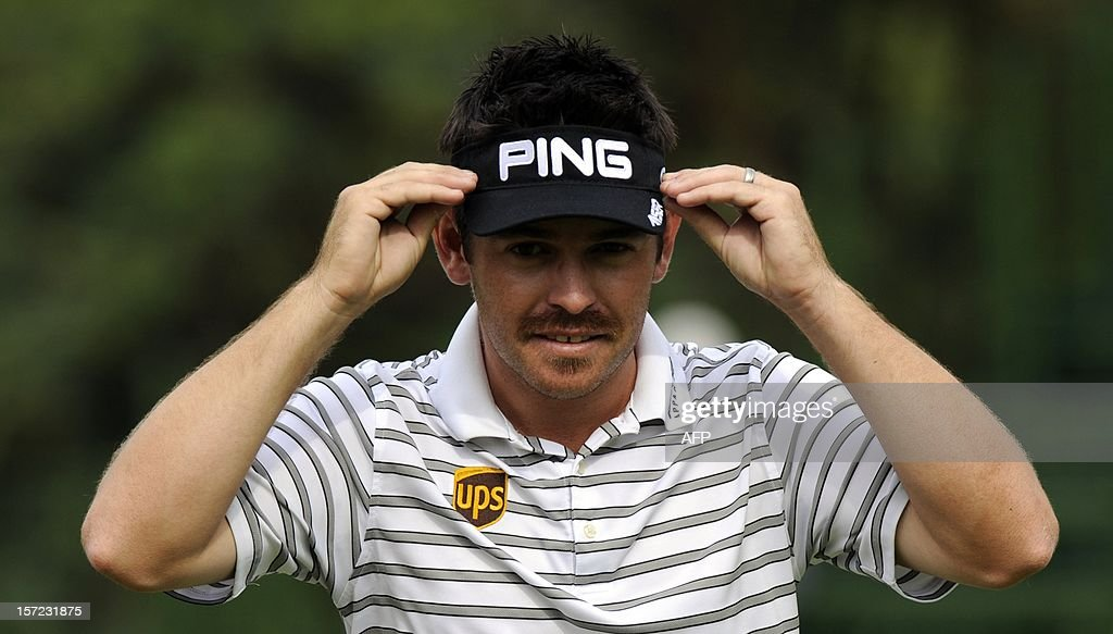 Louis Oosthuizen of South Africa adjusts his hat on day 2 of the 4 day 2012 Nedbank Golf Challenge in Sun City on November 30, 2012. AFP PHOTO / Alexander Joe