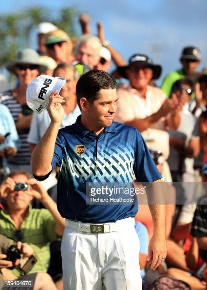 Louis Oosthuizen of South Africa aknowledges the crowd on the 18th green during the final round of the Volvo Champions at Durban Country Club on...