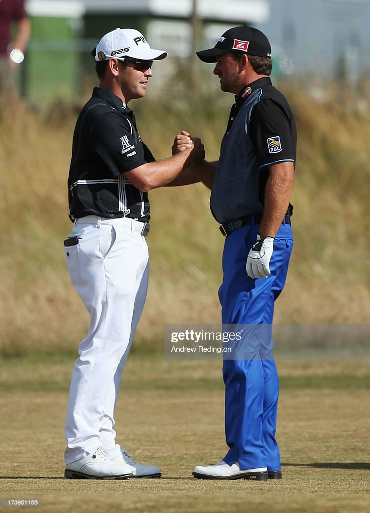 Louis Oosthuizen of South Africa and and Graeme McDowell of Northern Ireland shake hands after Oosthuizen withdraws due to injury during the first round of the 142nd Open Championship at Muirfield on July 18, 2013 in Gullane, Scotland.