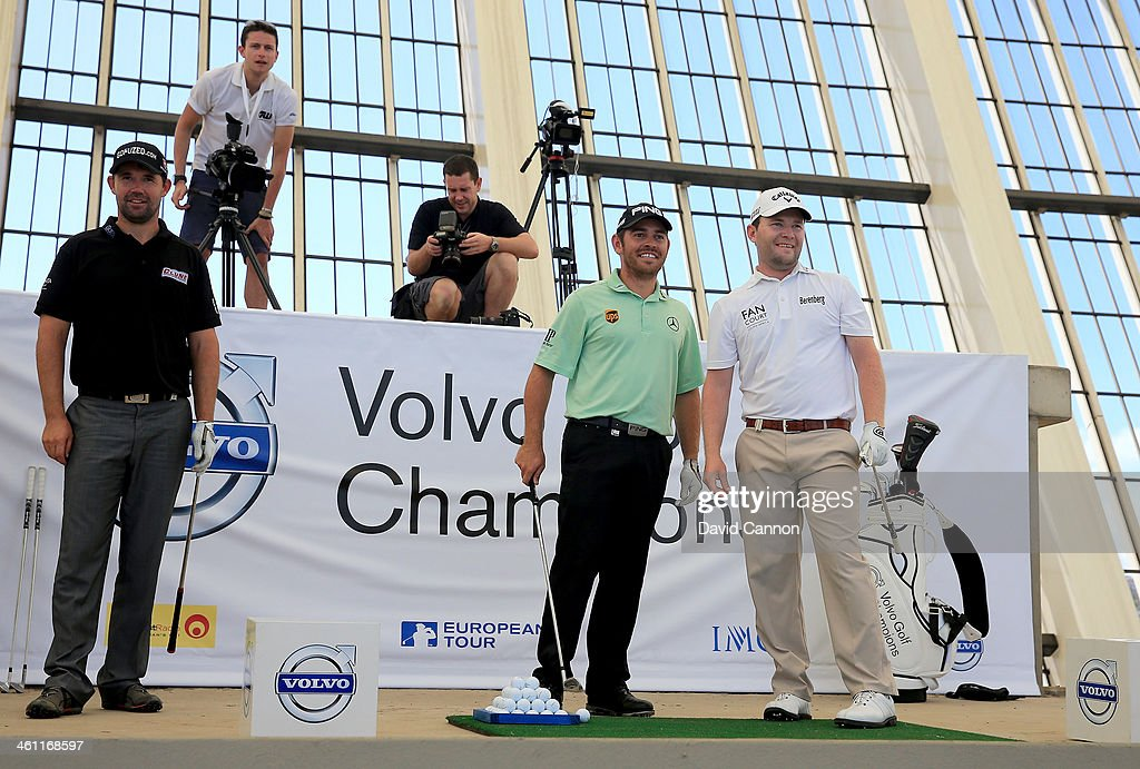 Louis Oosthuizen of South Africa and Branden Grace of South Africa watch Grace's ball as Padraig Harrington of Ireland looks on during The Volvo Golf Champions Moses Mabhida Stadium Challenge as a preview for the 2014 Volvo Golf Champions tournament at Durban Country Club on January 7, 2014 in Durban, South Africa.