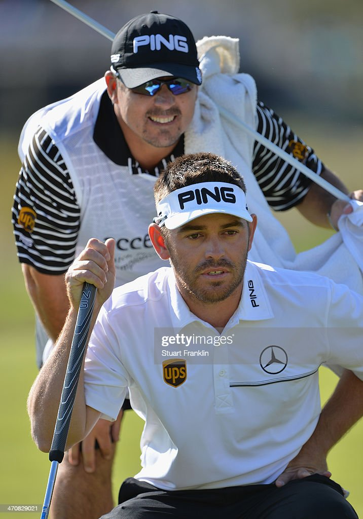 Louis Oosthuizen of South Africa and caddie line up a putt on the 15th hole during the second round of the World Golf Championships - Accenture Match Play Championship at The Golf Club at Dove Mountain on February 20, 2014 in Marana, Arizona.