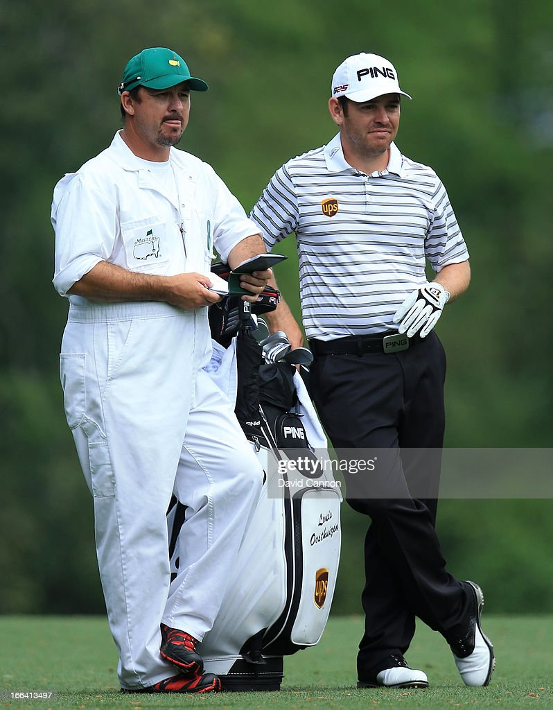 Louis Oosthuizen of South Africa and his caddie Wynand Stander during the second round of the 2013 Masters Tournament at Augusta National Golf Club on April 12, 2013 in Augusta, Georgia.