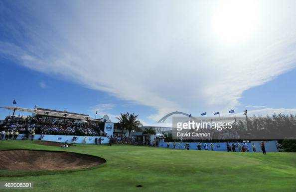 Louis Oosthuizen of South Africa and Joost Luiten of The Netherlands on the 18th green during the final round of the 2014 Volvo Golf Champions at...
