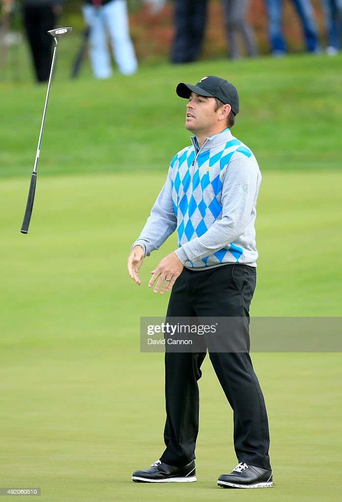 <a gi-track='captionPersonalityLinkClicked' href=/galleries/search?phrase=Louis+Oosthuizen&family=editorial&specificpeople=241573 ng-click='$event.stopPropagation()'>Louis Oosthuizen</a> of South Africa and the International Team reacts as his putt for par misses on the sixth hole in his match with Branden Grace against Patrick Reed and <a gi-track='captionPersonalityLinkClicked' href=/galleries/search?phrase=Rickie+Fowler&family=editorial&specificpeople=4466576 ng-click='$event.stopPropagation()'>Rickie Fowler</a> of the United States during the Saturday morning foursomes matches at The Presidents Cup at Jack Nicklaus Golf Club Korea on October 10, 2015 in Songdo IBD, Incheon City, South Korea.