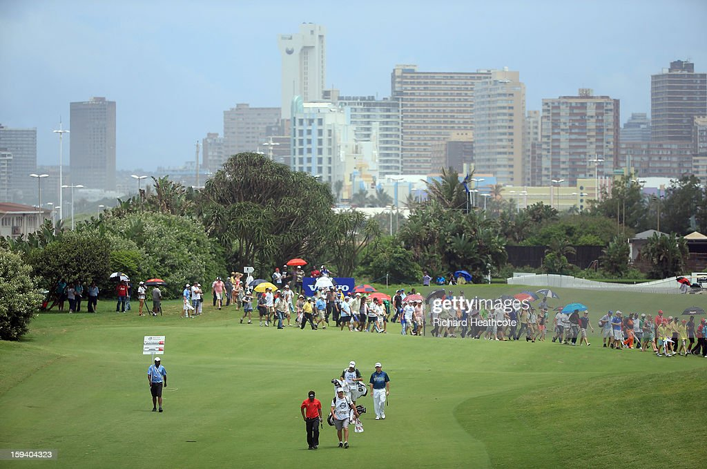 Louis Oosthuizen of South Africa and Thongchai Jaidee of Thailand walk down the 1st fairway during the final round of the Volvo Champions at Durban Country Club on January 13, 2013 in Durban, South Africa.
