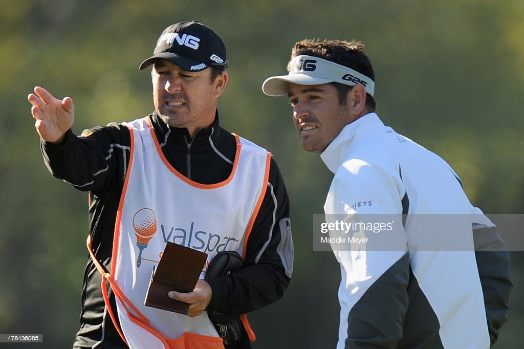 Louis Oosthuizen of South Africa assesses a tee shot on the 6th hole with his caddy during the first round of the Valspar Championsihp at Innisbrook Resort and Golf Club on March 13, 2014 in Palm Harbor, Florida.