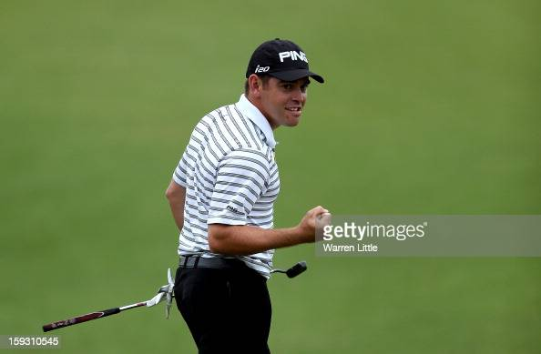Louis Oosthuizen of South Africa celebrates after holing a birdie putt on the 18th green to help his team win the proam competition during the second...