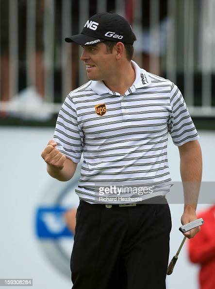 Louis Oosthuizen of South Africa celebrates as he holes a birdie putt on the 18th green to take the lead and help his team win the proam competition...