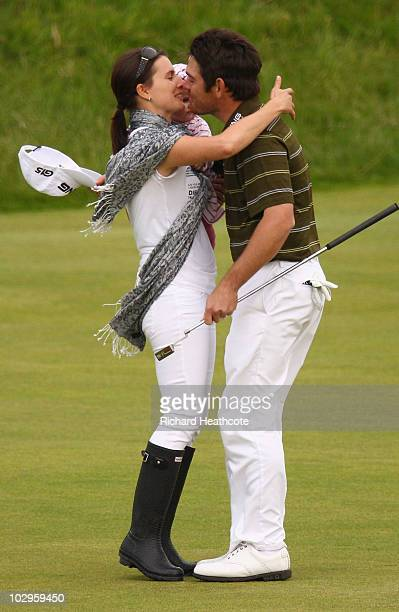 Louis Oosthuizen of South Africa celebrates his sevenstroke victory with his wife NelMare and daughter Jana on the 18th green at the 139th Open...