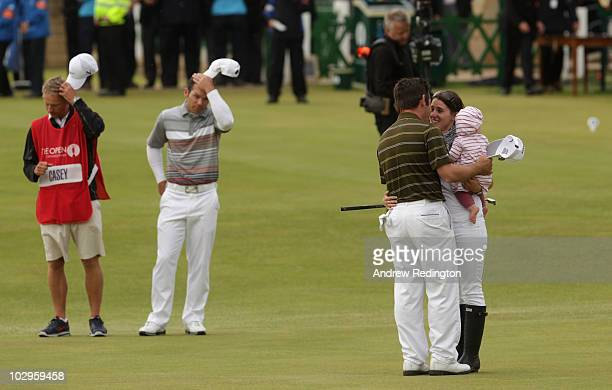 Louis Oosthuizen of South Africa celebrates his sevenstroke victory with his wife NelMare and daughter Jana on the 18th green as Paul Casey of...