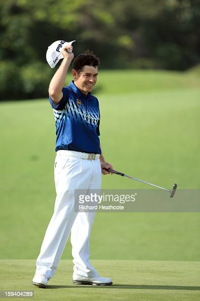 Louis Oosthuizen of South Africa celebrates victory on the 18th green during the final round of the Volvo Champions at Durban Country Club on January...