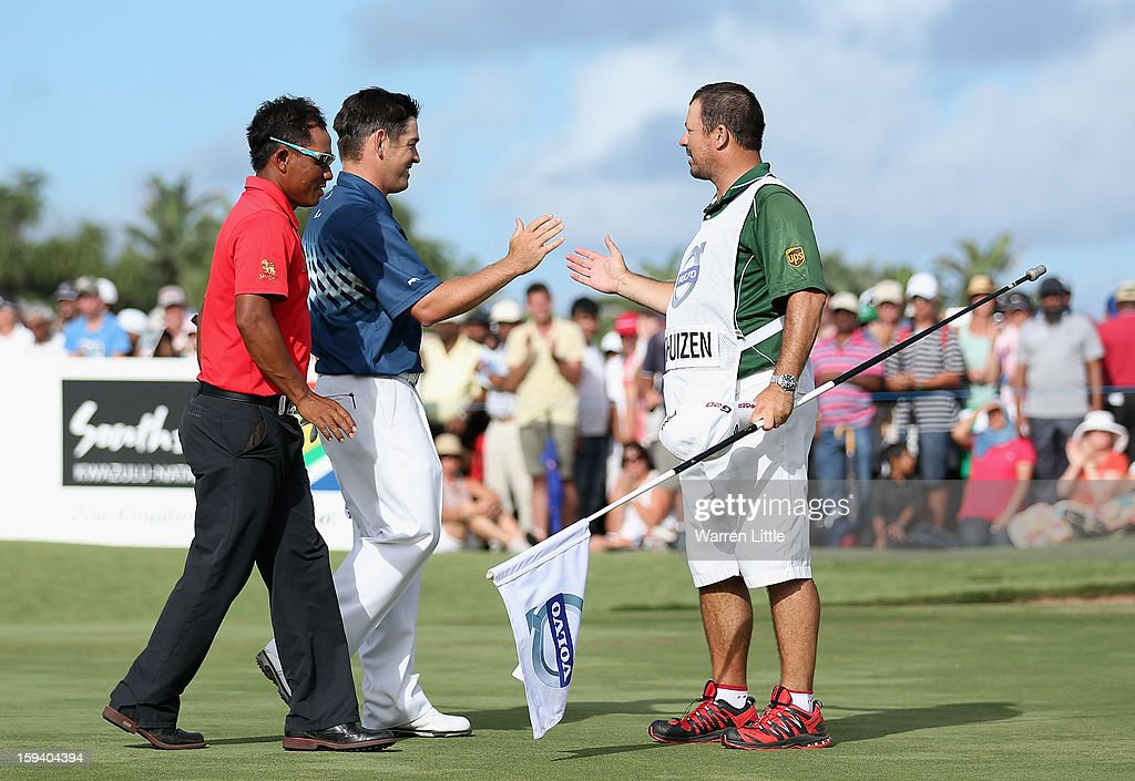 Louis Oosthuizen of South Africa celebrates with his caddie Wynand Stander after winning the Volvo Golf Champions on a score of -16 under par at Durban Country Club on January 13, 2013 in Durban, South Africa.
