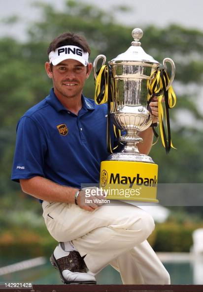 Louis Oosthuizen of South Africa celebrates with the trophy after winning the final round of the Maybank Malaysian Open at Kuala Lumpur Golf Country...