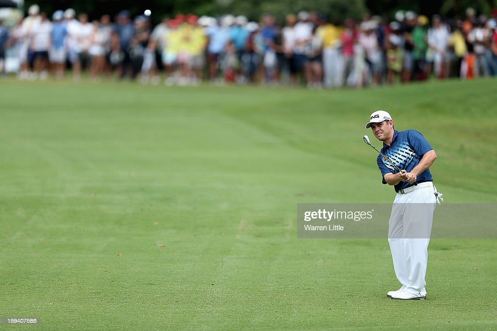Louis Oosthuizen of South Africa chips into the sixth green during the final round of the Volvo Golf Champions at Durban Country Club on January 13, 2013 in Durban, South Africa.