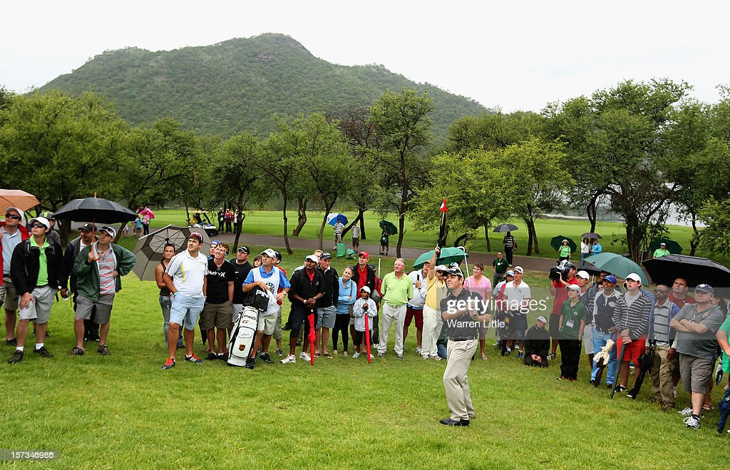 <a gi-track='captionPersonalityLinkClicked' href=/galleries/search?phrase=Louis+Oosthuizen&family=editorial&specificpeople=241573 ng-click='$event.stopPropagation()'>Louis Oosthuizen</a> of South Africa chips onto the 19th green during the final round of the Nedbank Golf Challenge at the Gary Player Country Club on December 2, 2012 in Sun City, South Africa.