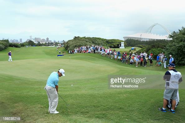Louis Oosthuizen of South Africa chips onto the first green during the first round of the Volvo Champions at Durban Country Club on January 10 2013...