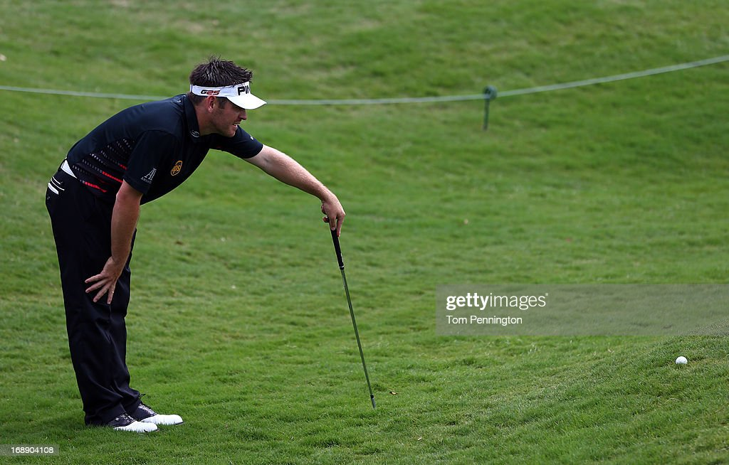 Louis Oosthuizen of South Africa eyes a chip shot during the first round of the 2013 HP Byron Nelson Championship at the TPC Four Seasons Resort on May 16, 2013 in Irving, Texas.
