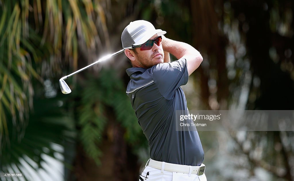 Louis Oosthuizen of South Africa hits a shot during a practice round prior to the start of the World Golf Championships-Cadillac Championship at Trump National Doral on March 5, 2014 in Doral, Florida.