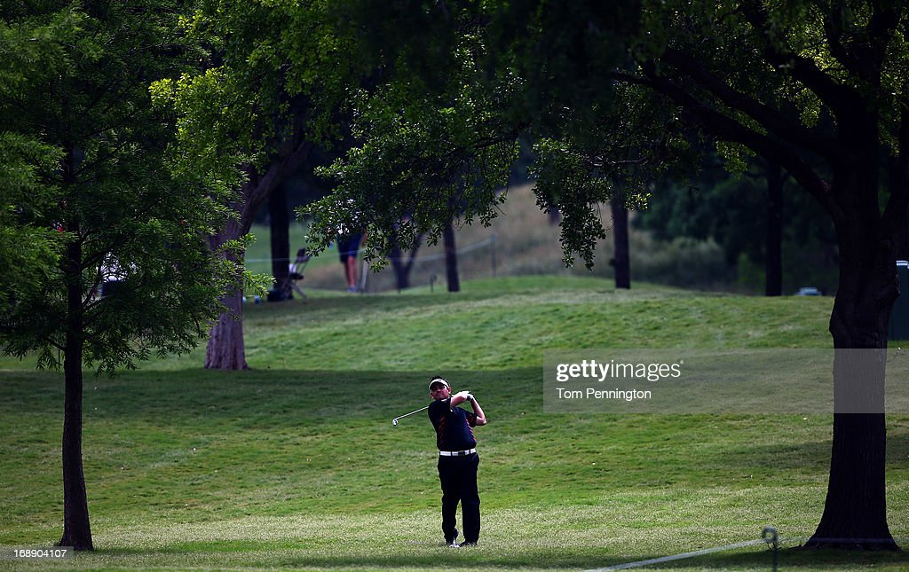 Louis Oosthuizen of South Africa hits a shot during the first round of the 2013 HP Byron Nelson Championship at the TPC Four Seasons Resort on May 16, 2013 in Irving, Texas.