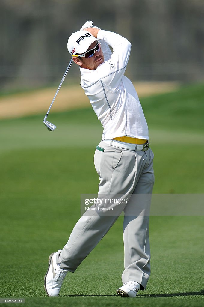 Louis Oosthuizen of South Africa hits a shot during the second round of the World Golf Championships - Accenture Match Play at the Golf Club at Dove Mountain on February 22, 2013 in Marana, Arizona.